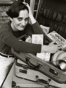 "Deborah Hoffmann with her mother's suitcase (from ""the Suitcase Period""), packed with Lorna Doone cookies."