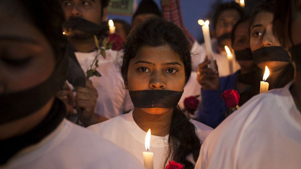 Indian women participate in a candle light vigil at a bus stop where the victim of a deadly gang rape in a moving bus had boarded the bus two years ago, in New Delhi, India, Tuesday, Dec. 16, 2014. The case sparked public outrage and helped make women's safety a common topic of conversation in a country where rape is often viewed as a woman's personal shame to bear. (AP Photo/Tsering Topgyal)